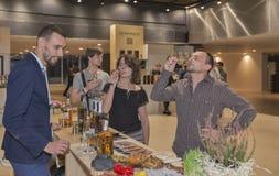 Whisky Dram Festival in Kiev, Ukraine. Unrecognized young visitors taste samples of Single Malt Scotch Whisky at 1st Ukrainian Whisky Dram Festival in Parkovy Royalty Free Stock Image