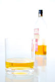 Whisky glass with bottle Stock Image
