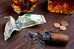 Whisky in a glass with a cigar, money, and a carafe of vintage Stock Photo