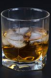 Whisky in a glass with ice Stock Photos