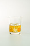 Whisky glass and ice Stock Photography