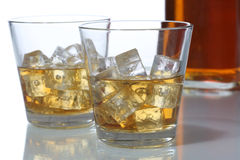 Whisky in a glass with ice cubes Stock Photos