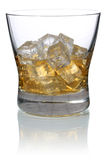 Whisky in a glass with ice cubes isolated Royalty Free Stock Image