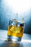 Whisky glass with ice cubes Royalty Free Stock Images