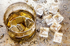 Whisky in a glass with stones. Whisky in a glass with ice and stones Royalty Free Stock Image