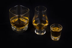 Whisky glasses. On a black background Royalty Free Stock Photo