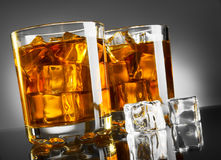 Whisky and ice Stock Images