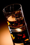 Whisky and ice cube Stock Photography