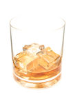 Whisky with ice cubes. Glass of whisky with three ice cubes isolated on white background Stock Images