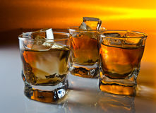 Whisky with ice. Focus on a foreground Royalty Free Stock Image
