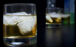 Whisky with ice in glasses Royalty Free Stock Photography