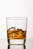 Whisky with ice on white background Stock Photography