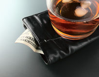 Whisky and money Royalty Free Stock Photography