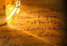 Whisky and old diary. Whiskey tumbler and whisky written by hand (spelt correctly Stock Photography