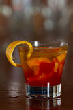 Whisky old fashioned. Classic cocktail, whisky old fashioned served on a busy out of focus bar Stock Photography