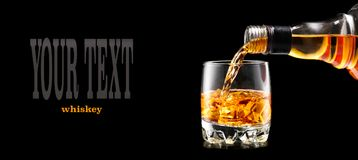 Free Whisky Pouring From The Bottle Over Black. Whiskey On The Rocks Stock Image - 103777161