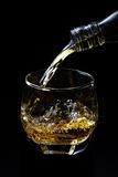 Whisky pouring Royalty Free Stock Image
