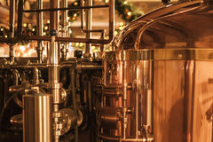 Whisky production. Large, copper container for whisky, many reflections of light Stock Photos