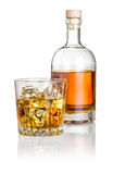 Whisky on the rocks with a bottle Stock Photography