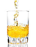 Whisky,rum or any other golden liquor being poured Royalty Free Stock Image