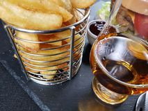 Whisky single malt glencairn chips chipbasket Royalty Free Stock Photo