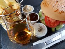 Whisky single malt glencairn sauces burger Royalty Free Stock Images