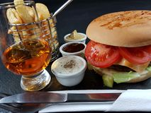 Whisky single malt glencairn sauces burger Stock Images