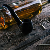 Whisky and smoking pipe Royalty Free Stock Photography