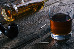 Whisky and smoking pipe Stock Images
