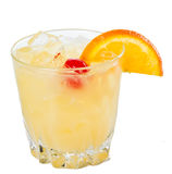 Whisky sour. Traditional whiskey sour cocktail served on the rocks garnished wiht a red cherry and an orange slice royalty free stock photo