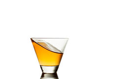 Whisky splash in glass isolated on a white background Stock Images
