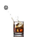 Whisky splash and ice isolated Stock Images