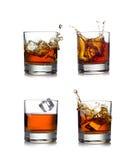 Whisky splash isolated on a white background Stock Photos
