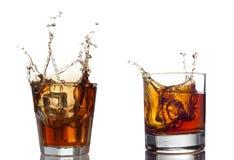 Whisky splash  on a white background Royalty Free Stock Photos