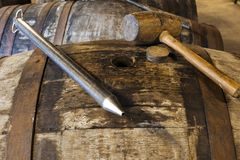 Whisky thief or valinch and wooden hammer. WHISKY THIEF or VALINCH. Used as a pipette by the master distiller to extract a sample of whisky from a barrel for Royalty Free Stock Images