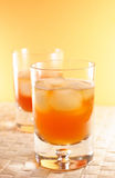 Whisky, whiskey. Two whisky glasses in yellow and orange colourtones stock photos