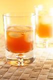 Whisky, whiskey. Two whisky glasses in yellow and orange colourtones royalty free stock photo