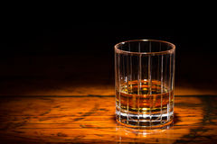 Whisky and Wood in Spotlight Royalty Free Stock Photography