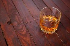 Whisky on wood Stock Image