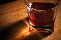 Whisky on a wooden table Royalty Free Stock Image