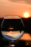 Whiskyglas bij zonsondergang Stock Foto