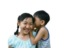 Whisper. Two young asian kids royalty free stock photo
