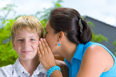 Whisper. Portrait of a young boy with his mother in summer environment Stock Image