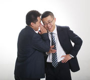 Whisper from businessman. One businessman whisper to another royalty free stock photo