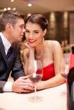 Whisper. Couple flirting in restaurant, passion love Stock Images