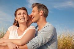 Whisper couple Stock Image