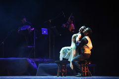 In a whisper-the identity of the mystery-Tango Dance Drama Stock Photo