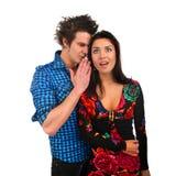 Whispered couple Stock Photo