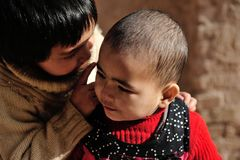 Whispering Children. This photo was taken during my trip at Xin Jiang, A cute Kashi Uygur girls are whispering Royalty Free Stock Photos