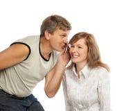 Whispering couple Royalty Free Stock Image
